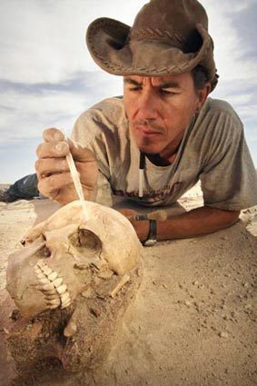 Paleontologist Paul Sereno of the University of Chicago stabilizes a nearly perfect preserved skull of a Tenerian, nomadic people that lived 6,500 to 4,500 years ago when the Sahara was an oasis.
