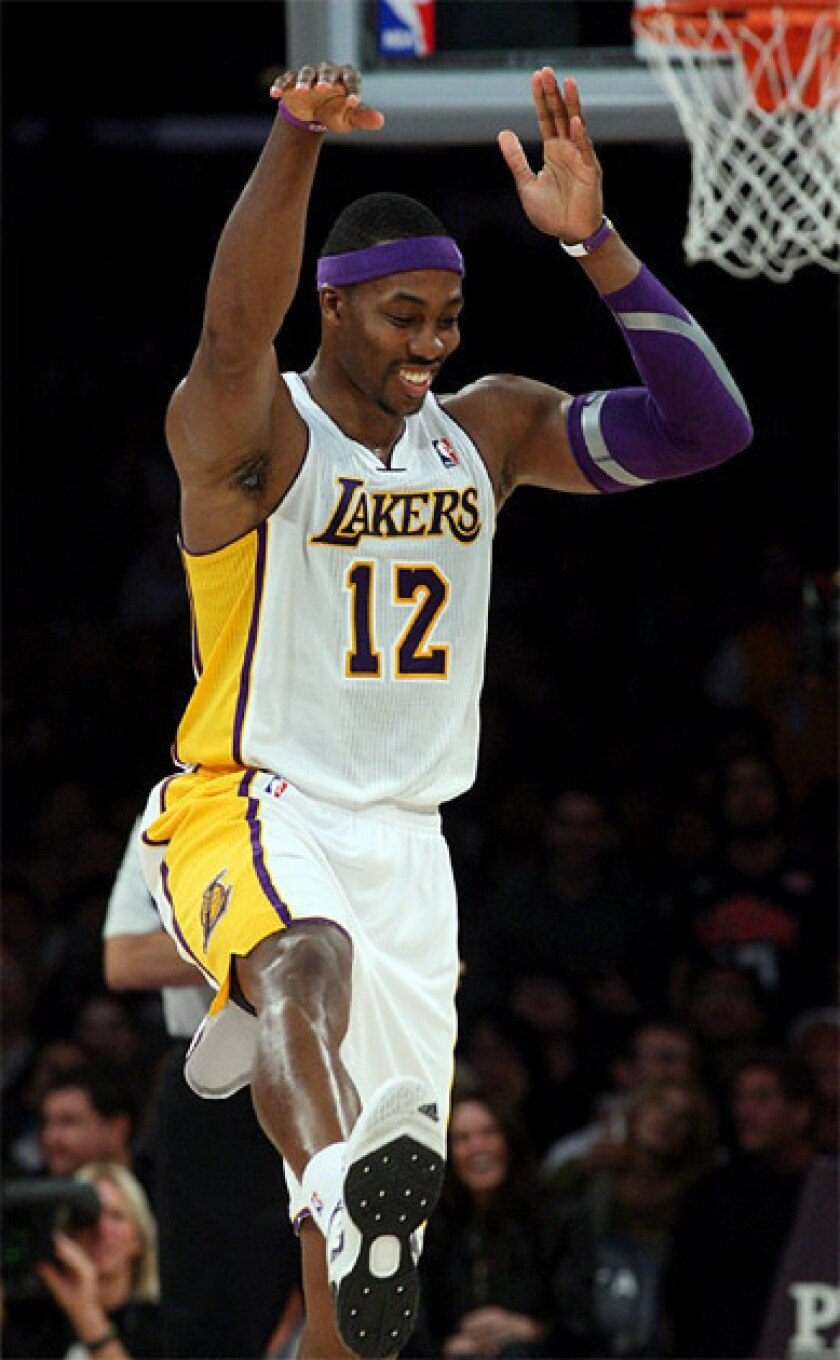 Dwight Howard celebrates after throwing down the dunk.