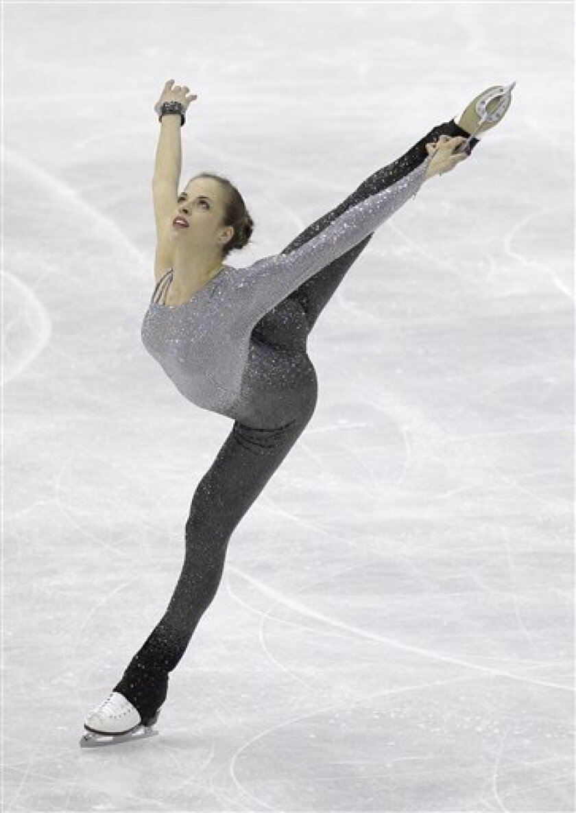 Carolina Kostner of Italy performs during her women's free skating program at the 2012 World Figure skating Championships in Nice, southern France, Saturday, March 31, 2012. (AP Photo/Lionel Cironneau)