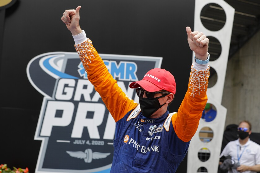 Scott Dixon celebrates his IndyCar Grand Prix victory at Indianapolis Motor Speedway on Saturday.
