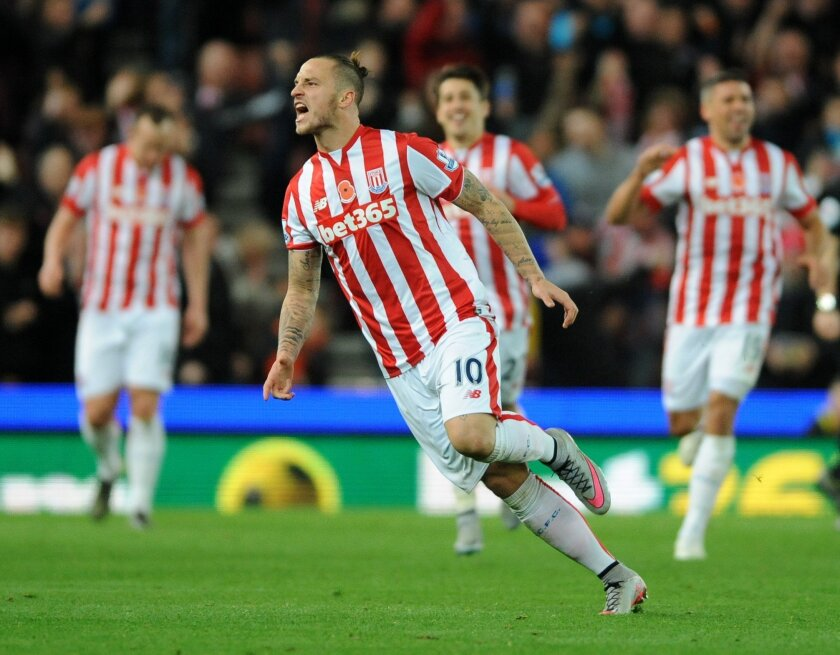 Stoke's Marko Arnautovic celebrates after scoring against Chelsea during the English Premier League soccer match between Stoke City and Chelsea at the Britannia Stadium, Stoke on Trent, England, Saturday, Nov. 7, 2015. (AP Photo/Rui Vieira)