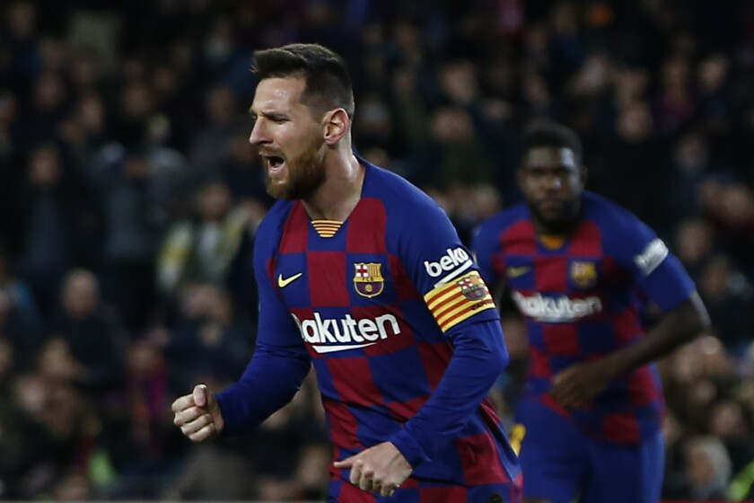 Barcelona's Lionel Messi celebrates after scoring his side's second goal during a Spanish La Liga soccer match between Barcelona and Celta at Camp Nou stadium in Barcelona, Saturday, Nov. 9, 2019. (AP Photo/Joan Monfort)