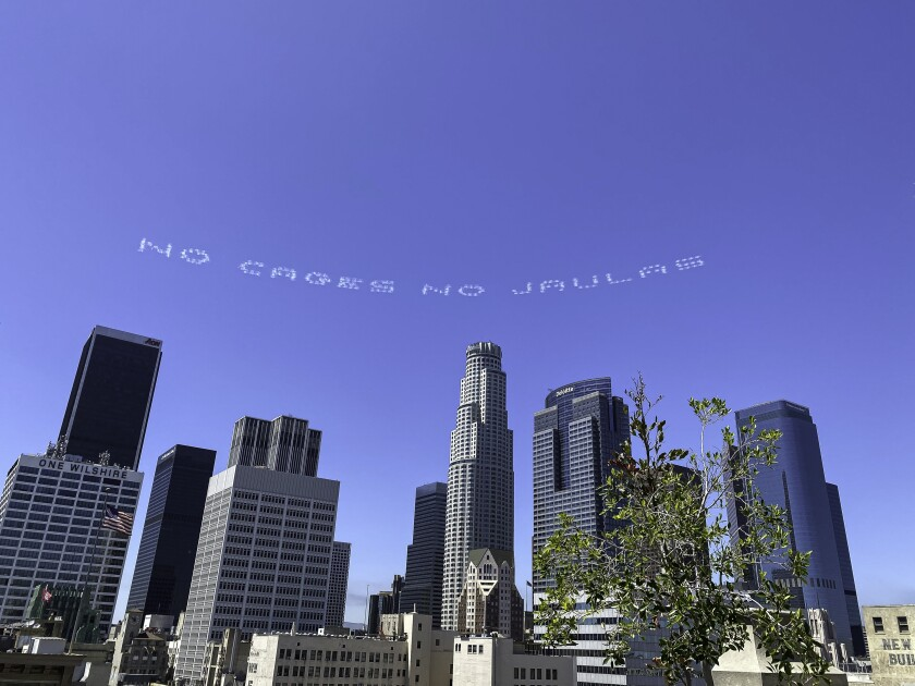 NO CAGES NO JAULAS reads a sky-typed message created by Beatriz Cortez over downtown L.A.