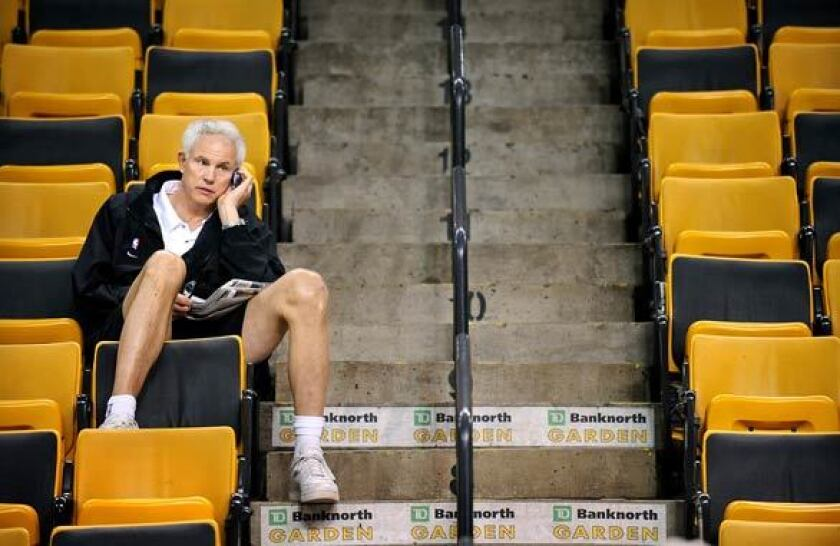 Lakers General Manager Mitch Kupchak on the phone during a 2008 practice at TD Garden in Boston.