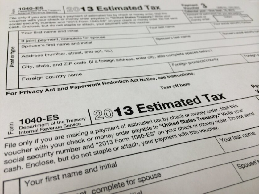 """This Thursday, Jan. 9, 2013 photo, shows a 2013 1040-ES IRS Estimated Tax form at H & R Block tax preparation office in the Echo Park district of Los Angeles. """"The United States income tax is a pay-as-you-go tax, which means that tax must be paid as you earn or receive your income during the year,"""" the IRS says. """"You can either do this through withholding or by making estimated tax payments."""" (AP Photo/Damian Dovarganes)"""
