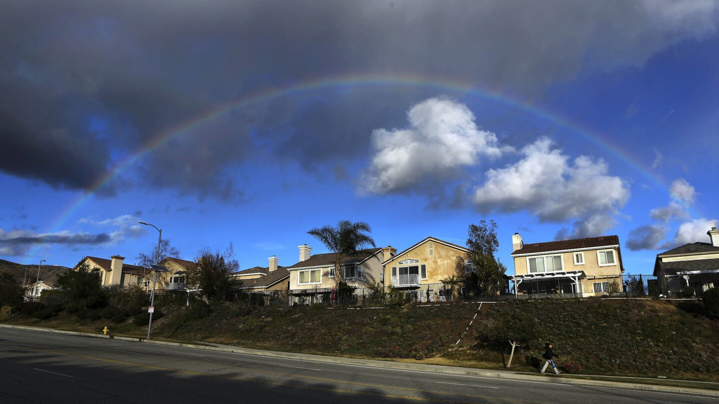 A rainbow forms over homes on Porter Ranch Drive in Porter Ranch on Jan. 7, 2016.
