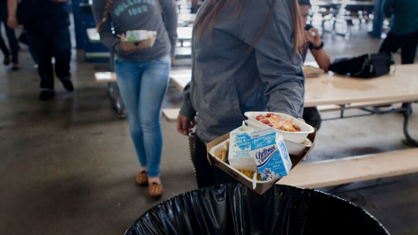 LOS ANGELES, CA - MARCH 7, 2014: Students throw away most of the hot meal lunch served on March 7, 2