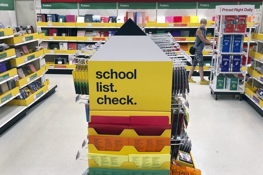 FILE - Back-to-school supplies await shoppers at a store in Marlborough, Mass., in this Saturday, July 11, 2020, file photo. This year's back-to-school shopping will include some unwanted lessons in dealing with supply-chain challenges. (AP Photo/Bill Sikes, File)