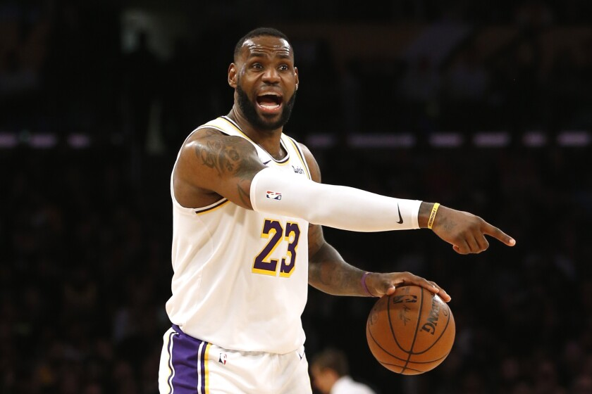 Lakers forward LeBron James calls out a play during a game against the Timberwolves on Dec. 8, 2019, at Staples Center.