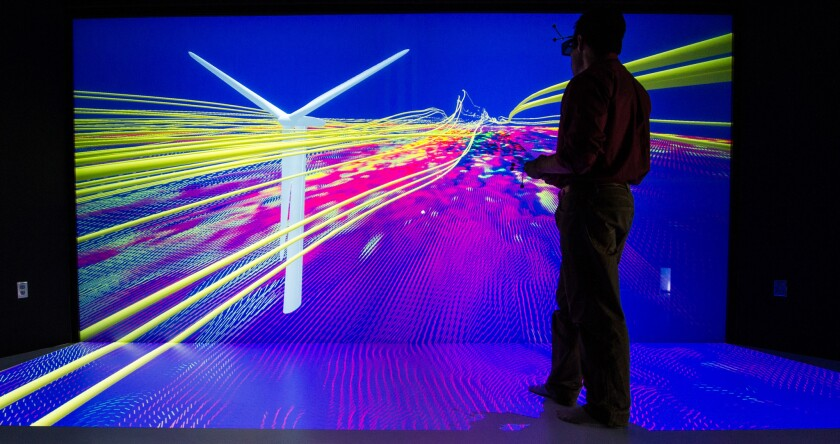 A scientist studies a wind turbine simulation at the Energy Systems Integration Facility in Golden, Colo.