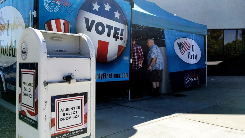 Idaho voters visit a food-truck-inspired pop-up voting location in Boise on Sept. 27.