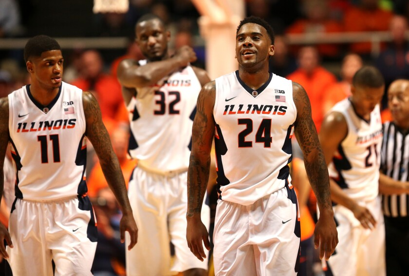 Illinois guard Rayvonte Rice (24) has a laugh going into a timeout.