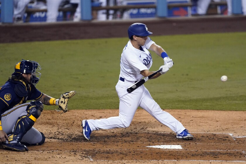 Dodgers catcher Austin Barnes hits a run-scoring single during the fifth inning.