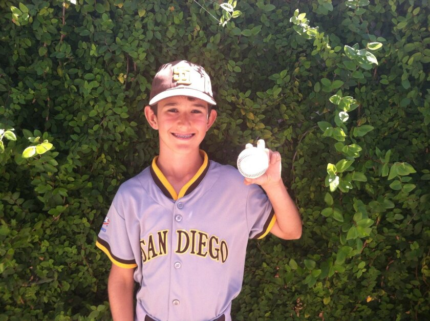 Bronco player Manny Butler shows off his Grand Slam ball that led to Sector 9 defeating Mission Bay 13-12.