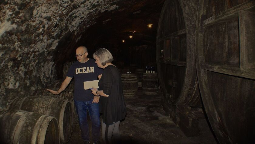 Philippe Tissot shares his family's winemaking techniques with Sheila Van Metre of Escondido.