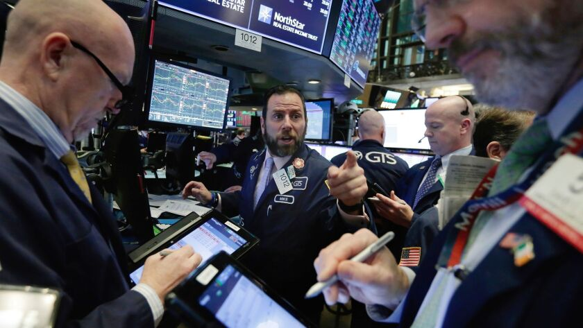 Traders on the floor of the New York Stock Exchange on Feb. 7.