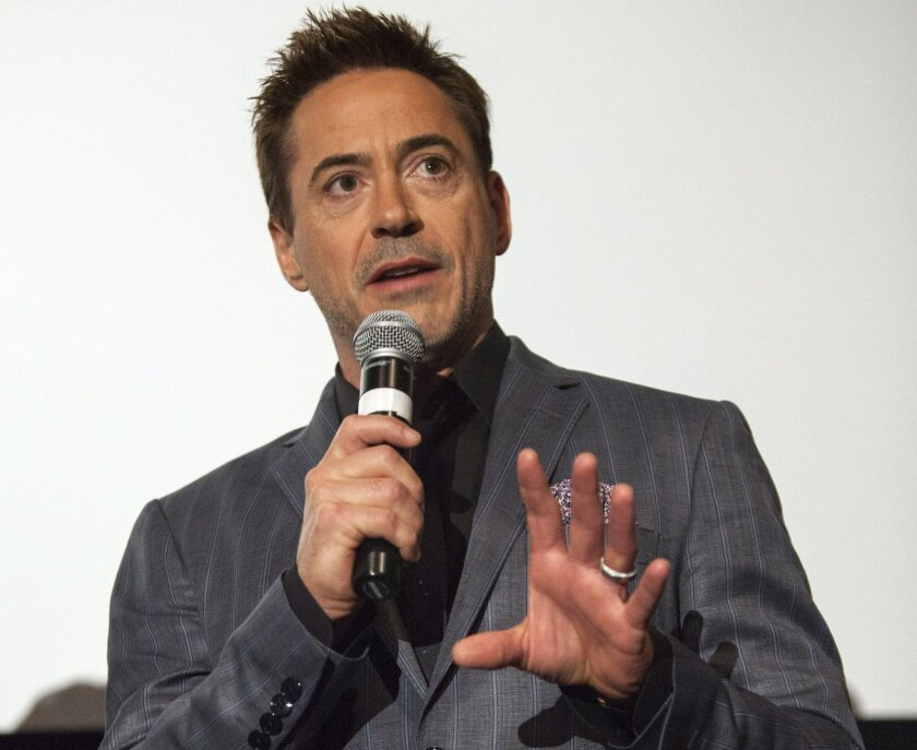 """FILE - In this Sunday, Oct. 5, 2014, file photo, actor Robert Downey Jr. attends the 50th Chicago International Film Festival's Pre-Festival Gala Screening of """"The Judge"""" at the AMC River East, in Chicago. Downey made a surprise appearance Sunday, Oct. 5, 2014, at Wright-Patterson Air Force Base in Ohio, for a screening of his new movie, """"The Judge,"""" which opens Friday. (Photo by Barry Brecheisen/Invision/AP, File)"""