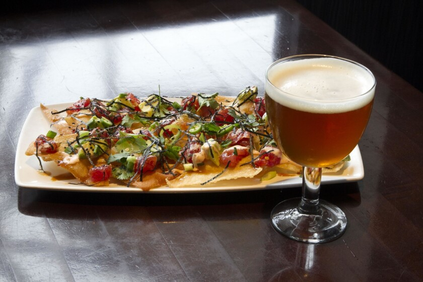 """At the Yard House restaurant in Mission Valley, chef Dan Castillo prepared """"Poke nachos"""" and a suggested beer to accompany it is the Triple IPA from Green Flash called """"3 Degrees of Celebration."""" (John Gibbins/U-T)"""