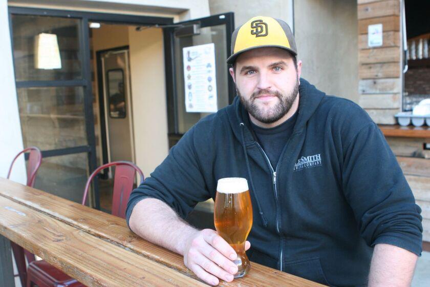 Thomas Peters, brewer at Belching Beaver enjoying a Tiny Rick (Liz Bowen)