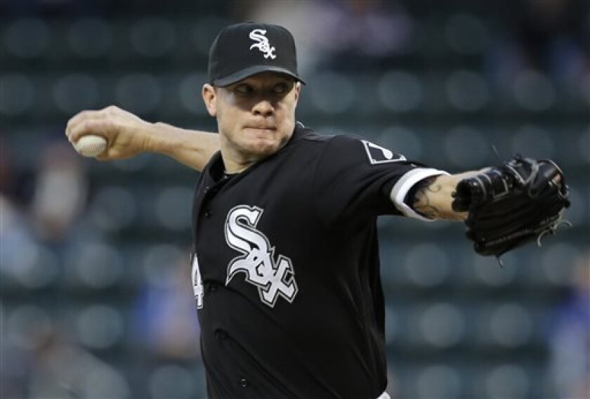 Chicago White Sox starting pitcher Jake Peavy winds up during the first inning of a baseball game against the New York Mets on Wednesday, May 8, 2013, in New York. (AP Photo/Seth Wenig)