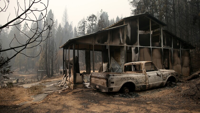 A burned-out truck sits in front of a structure that was destroyed by the King fire on Sept. 19 near Pollock Pines, Calif.