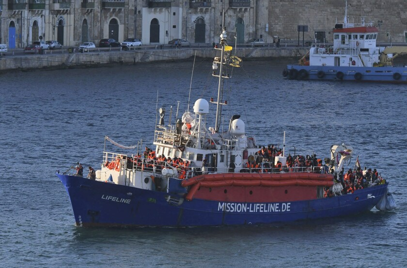 FILE - In this June 27, 2018 file photo a ship operated by German aid group Mission Lifeline, carrying 234 migrants, arrives at the Valletta port in Malta. The German government on Wednesday rejected claims by humanitarian groups that a change to ship safety rules will prevent the rescue of migrants at sea. Three groups that operate migrant rescue vessels in the Mediterranean accused Germany's Transport Ministry of 'insidious sabotage' by making them comply with rules designed for commercial ships rather than leisure boats, as is currently the case. (AP Photo/Jonathan Borg, file)