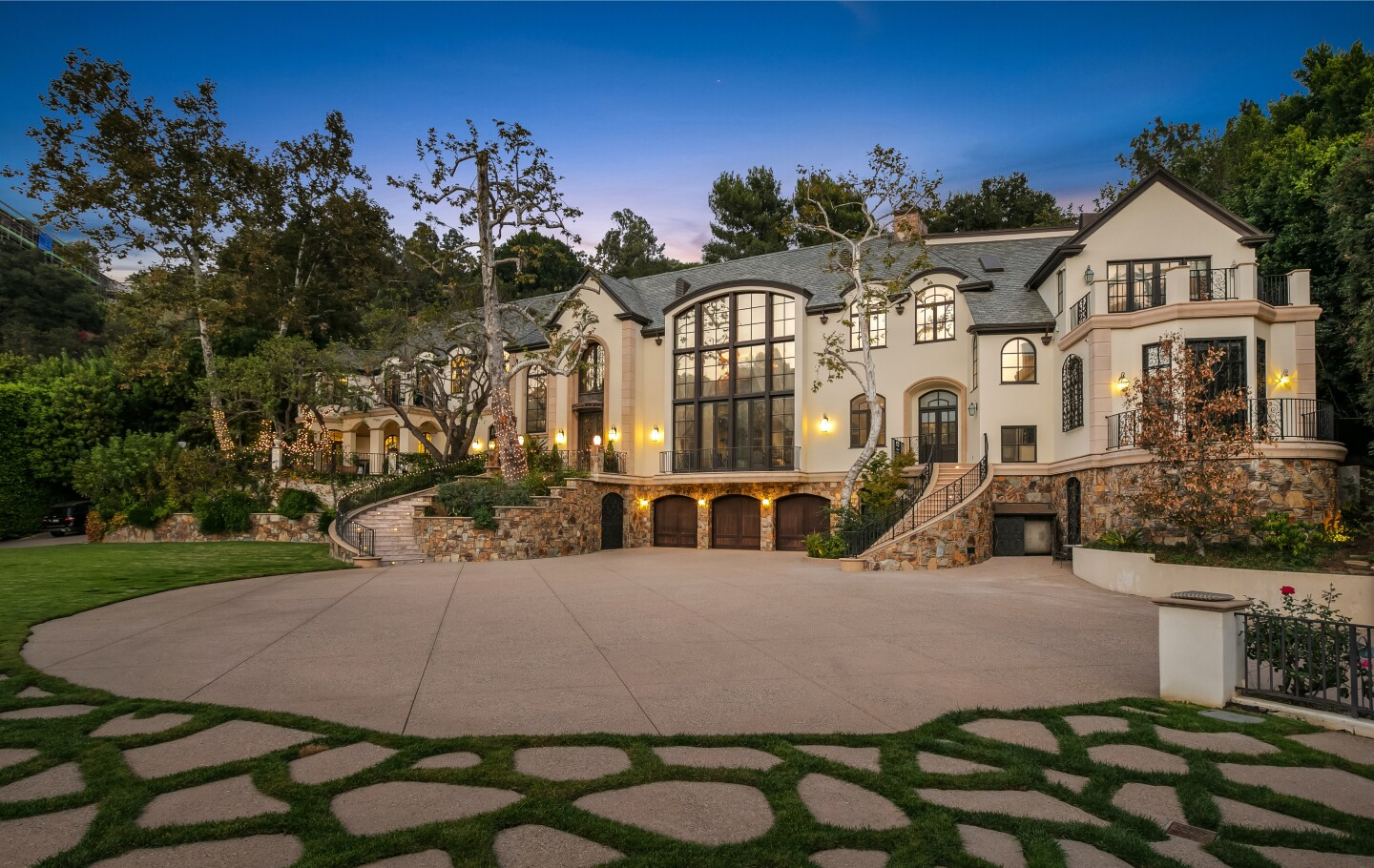 The compound includes a 16,000-square-foot mansion, a tennis court and a swimming pool with a 60-foot slide.