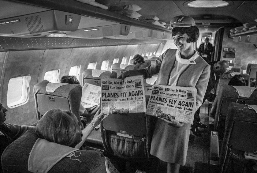 Aug. 20, 1966: Flight attendant Linda Spelman passes out copies of the Los Angeles Times to passengers aboard TWA flight.