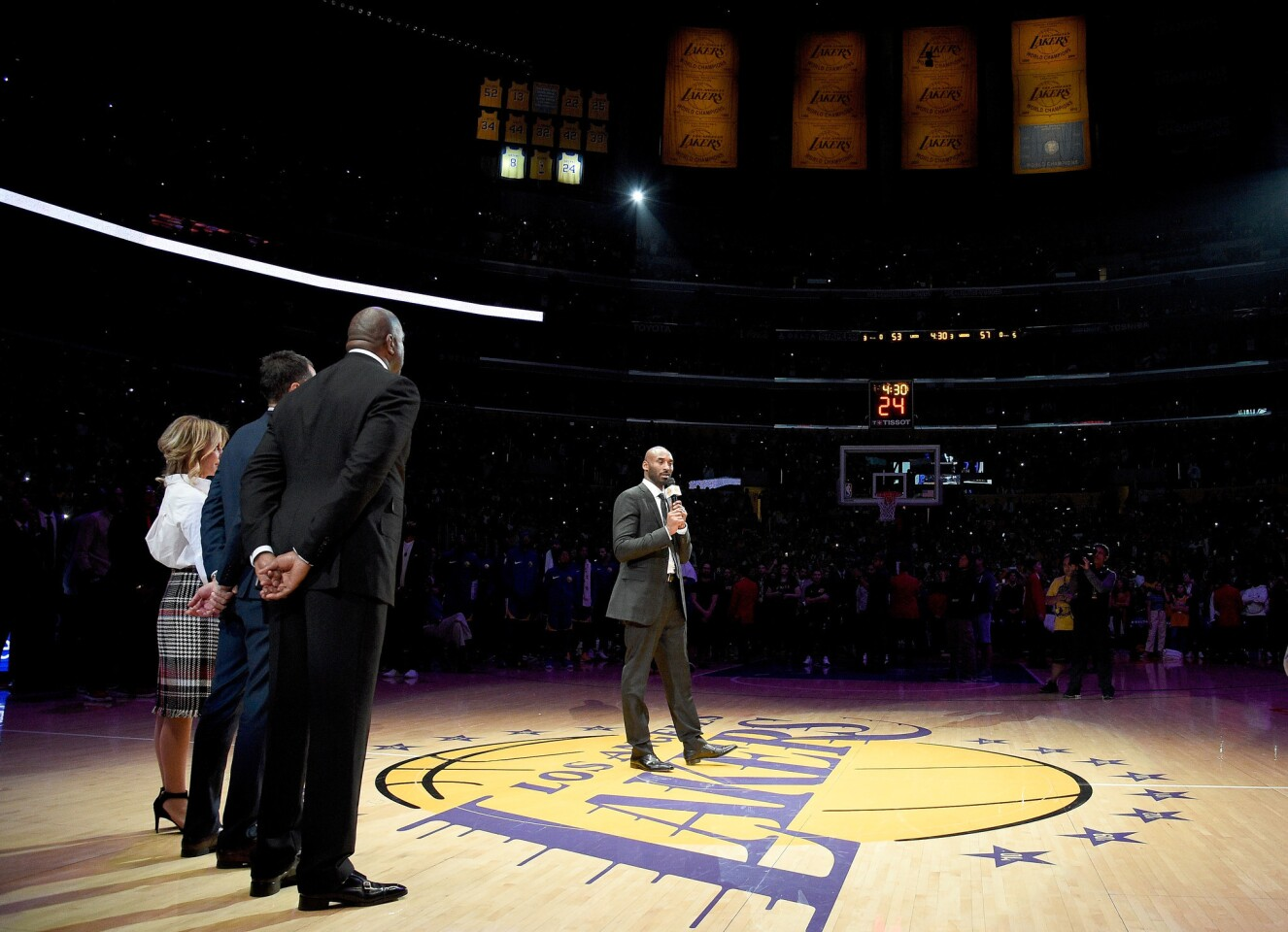 LOS ANGELES, CA - DECEMBER 18: Kobe Bryant addresses the crowd at halftime as both his #8 and #24 Los Angeles Lakers jerseys are retired at Staples Center on December 18, 2017 in Los Angeles, California. NOTE TO USER: User expressly acknowledges and agrees that, by downloading and or using this photograph, User is consenting to the terms and conditions of the Getty Images License Agreement.