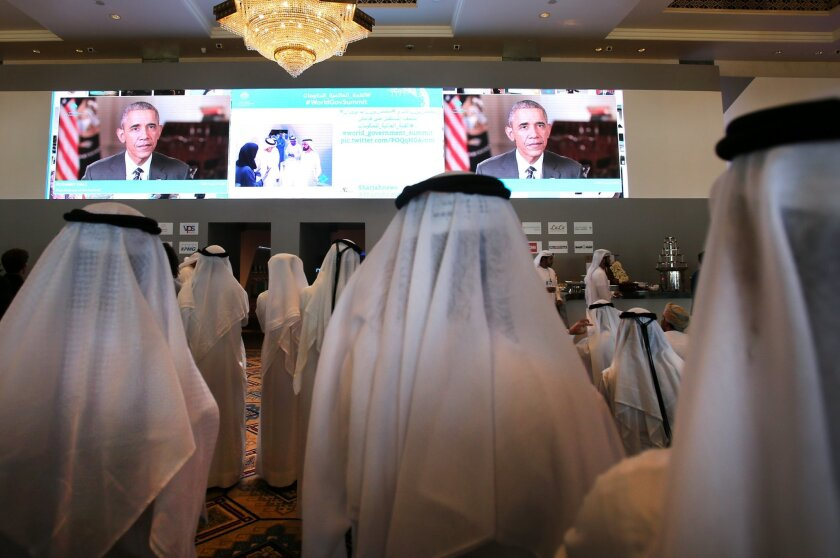 Emirati officials watch U.S. President Barack Obama's keynote address at the opening ceremony of the World Government Summit in Dubai, United Arab Emirates, Monday, Feb. 8, 2016. Those gathered for the World Government Summit in Dubai offered no immediate solutions to the crises gripping the region