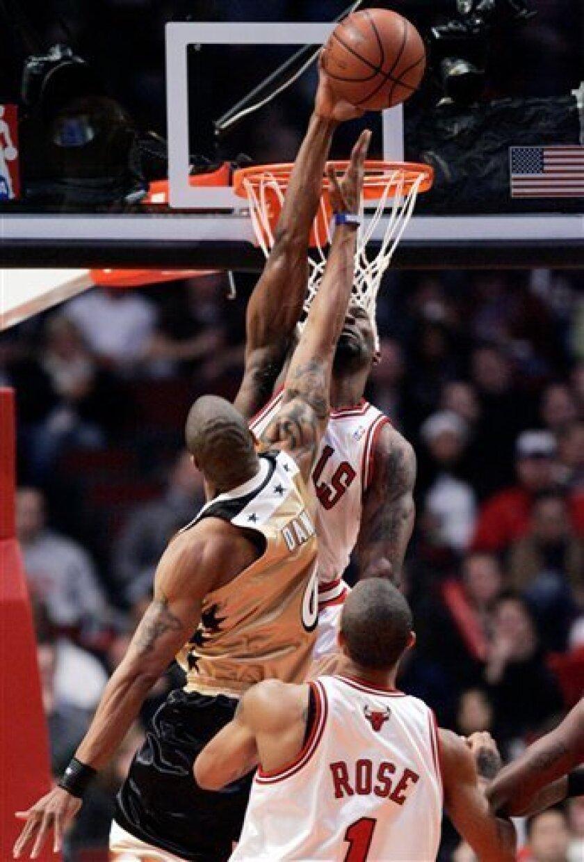 Chicago Bulls' Ben Gordon, top, blocks a shot by Washington Wizards' Antonio Daniels during the third quarter of an NBA basketball game Saturday, Dec. 6, 2008, in Chicago.(AP Photo/Nam Y. Huh)