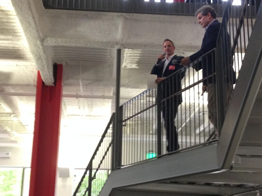 Gensler managing director Kevin Heinly addresses a crowd at the grand opening of the firm's new down