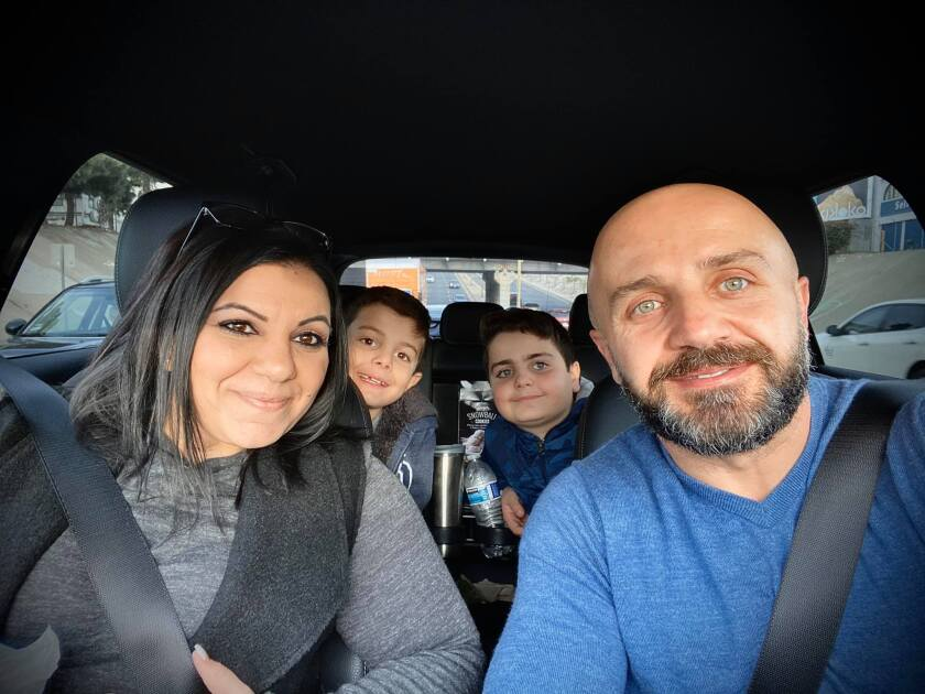 The Koroghlyan family in a vehicle