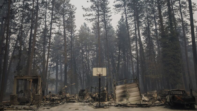 Pacific Gas & Electric Co. this week submitted a letter to regulators noting it found downed tree branches and bullet-riddled equipment in the area of the Camp fire. Above, the debris of a home destroyed by the blaze is pictured in Paradise in November.
