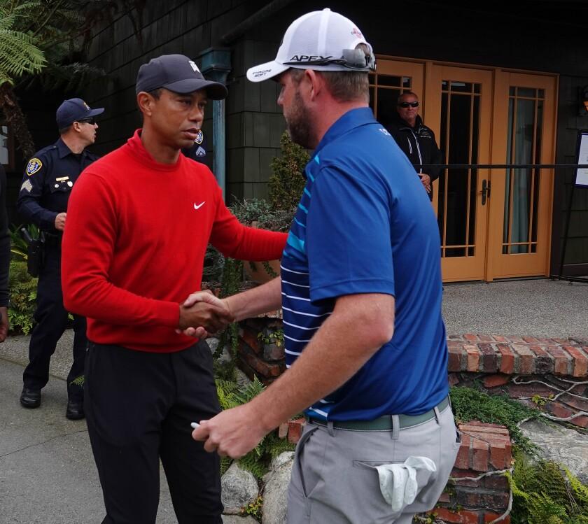 Tiger Woods congratulates Farmers Insurance Open winner Marc Leishman on Jan. 26, 2020