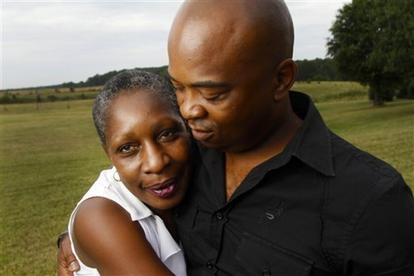 """In this June 22, 2011 photo, Elaine Riddick and her son Tony Riddick embrace as they pose for a photo before testifying before the Justice for Sterilization Victims Foundation task force compensation hearing in Raleigh, N.C. Riddick is fighting for compensation from her native state of North Carolina over her sterilization as a young girl. Between 1929 and 1974, North Carolina sterilized more than 7,600 individuals in the name of """"improving"""" the state's human stock. By the time the program was halted, the majority of those neutered were young, black, poor women _ like Riddick. (AP Photo/Jim R. Bounds)"""