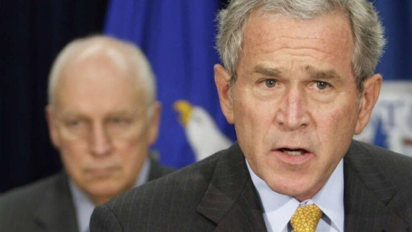 President George W. Bush delivers remarks on counterterrorism while Vice President Dick Cheney looks on at the J. Edgar Hoover FBI Building in 2007.