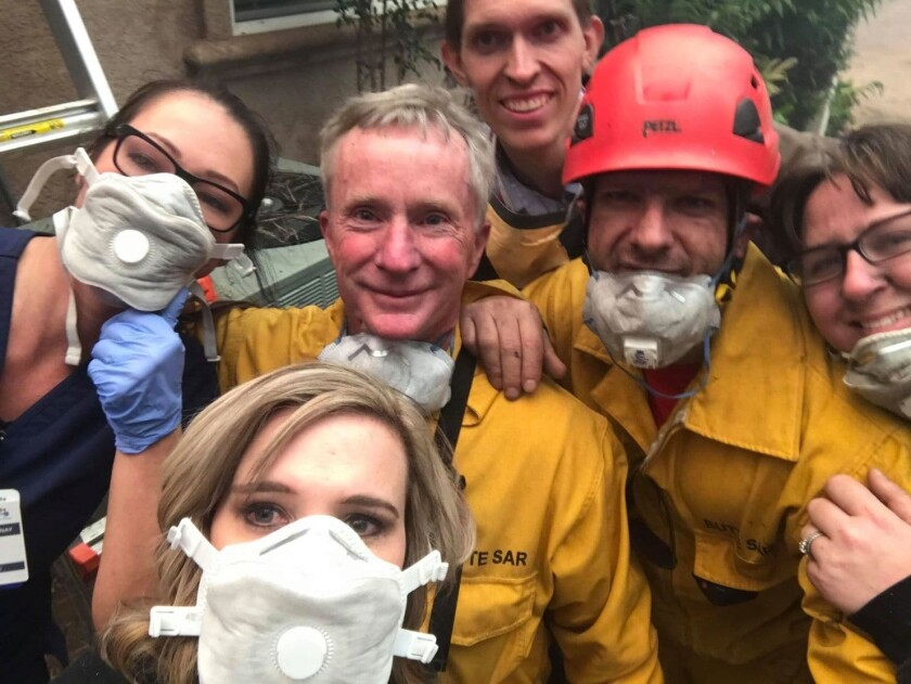 Tamara Ferguson, front, takes a selfie in front of a Paradise, Calif., house with a group trapped by flames: nurse Chardonnay Telly, left, firefighters Matt Arness and Joe Greco, EMT Shannon Molarius and Dr. David Russell, back.