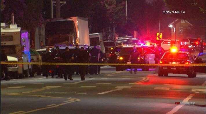 Gunman who opened fire on LAPD patrol car killed in shootout with police, officials say