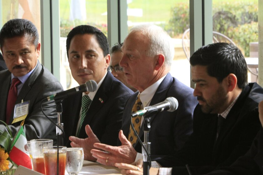 Political and business leaders from San Diego County and Baja California discuss cross-border goals for 2014. From left to right, Ensenada Mayor Gilberto Hirata Chico; San Diego Interim Mayor Todd Gloria; President of the San Diego Regional Chamber of Commerce Jerry Sanders. Photo by Louie Juarez/U