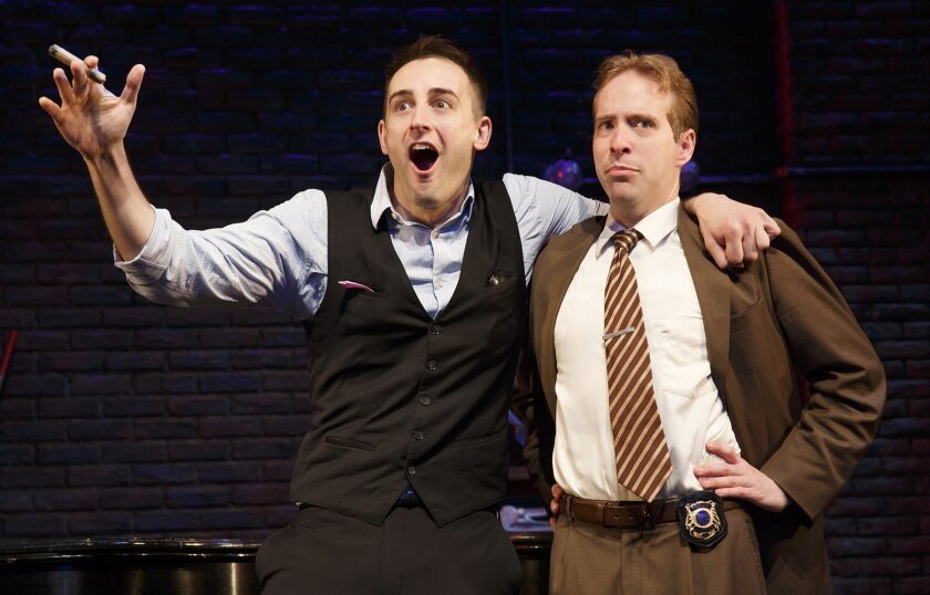 Joe Kinosian as The Suspects and Ian Lowe as Marcus star in 'Murder for Two,' through March 1 at The Old Globe Theatre.