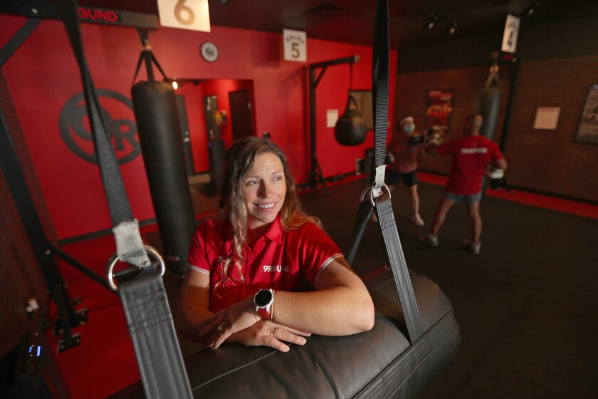 Ashley Richardson, franchise owner of 9Round Fitness gym in Long Beach, poses at her gym.