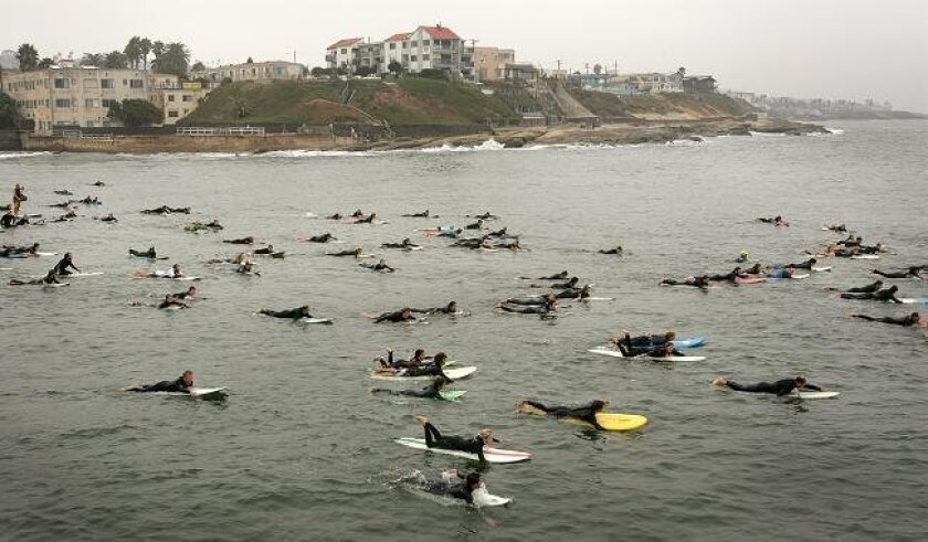 Participants in the 19th Annual Paddle for Clean Water, hosted by the San Diego Chapter of the Surfrider Foundation, make their way around the Ocean Beach Pier on Sunday, Sept. 12, 2010.