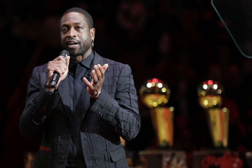 Former Miami Heat guard Dwyane Wade speaks during a jersey retirement ceremony.