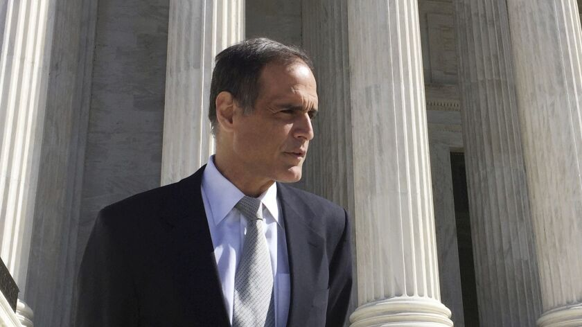 Florida resident Fane Lozman stands on the steps of the Supreme Court in Washington, after oral arguments in his case.