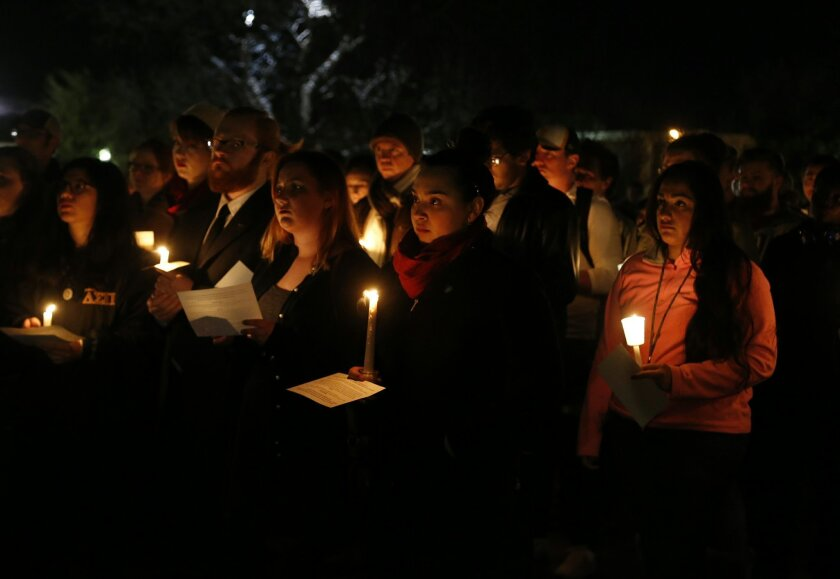 "Baylor students and alumni hold a candlelight vigil outside the home of Baylor University President Ken Starr, in what organizers' call a ""Survivors' Stand"", Monday, Feb. 8, 2016, in Waco, Texas. The students and supporters attended the event in an effort to urge changes to how the school handles s"