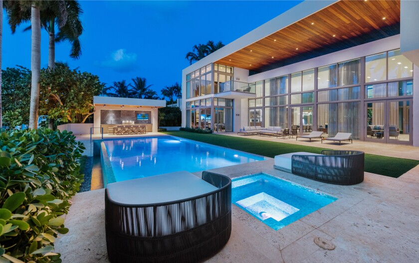 Newly renovated, the boxlike abode overlooks Biscayne Bay with a swimming pool, cabana and private dock.