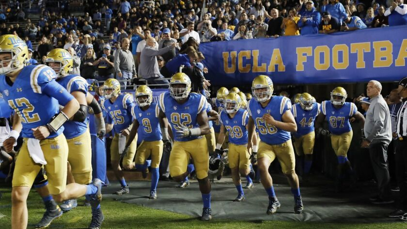 UCLA Bruins run onto the field at the Rose Bowl.