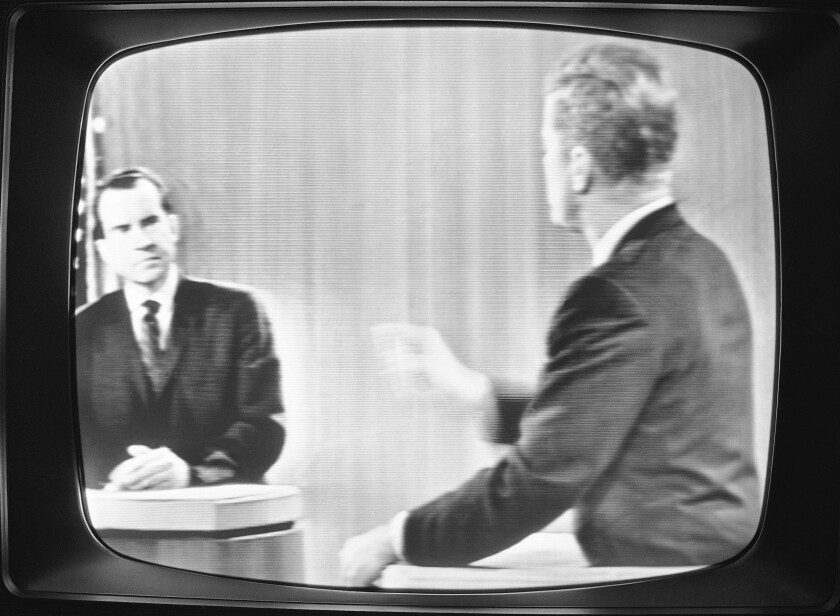 FILE - In this Oct. 21, 1960 file photo taken a television in New York displays a debate between Republican presidential candidate Vice President Richard M. Nixon, left, and Democratic presidential candidate Sen. John F. Kennedy, D-Mass. The 1960 presidential election offered the country's first televised debates. (AP Photo, File)