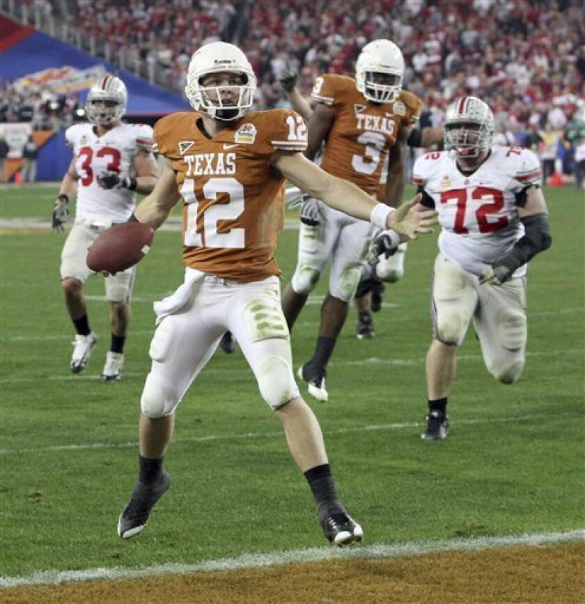 Texas quarterback Colt McCoy celebrates as he scores against Ohio State during the third quarter of the Fiesta Bowl NCAA college football game in Glendale, Ariz., Monday, Jan. 5, 2009. (AP Photo/Ross D. Franklin)